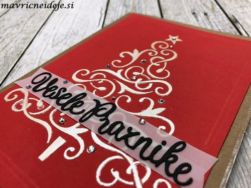 Nuvo embellishment mousse on red paper